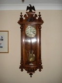 A walnut Vienna wall clock